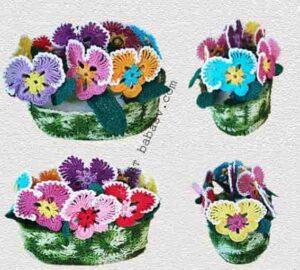 Коллекция цветов фиалок связана крючком по описанию